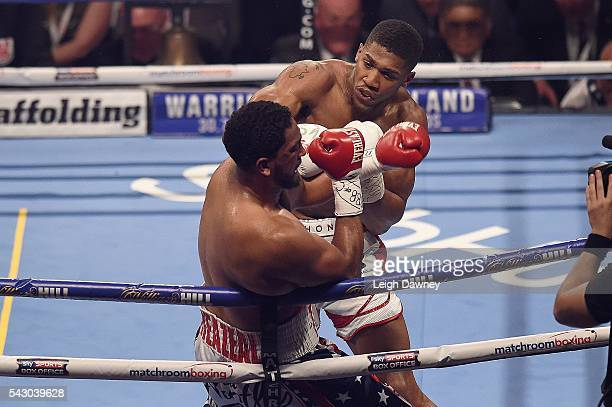 Anthony Joshua forces Dominic Breazeale against the ropes The IBF World Heavyweight Title fight at The O2 Arena on June 25 2016 in London England