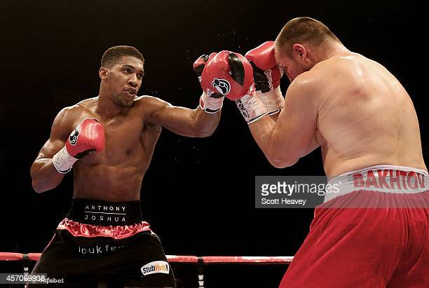 Anthony Joshua in action with Denis Bakhtov during their Vacant WBC International Heavyweight Championship bout at O2 Arena on October 11 2014 in...