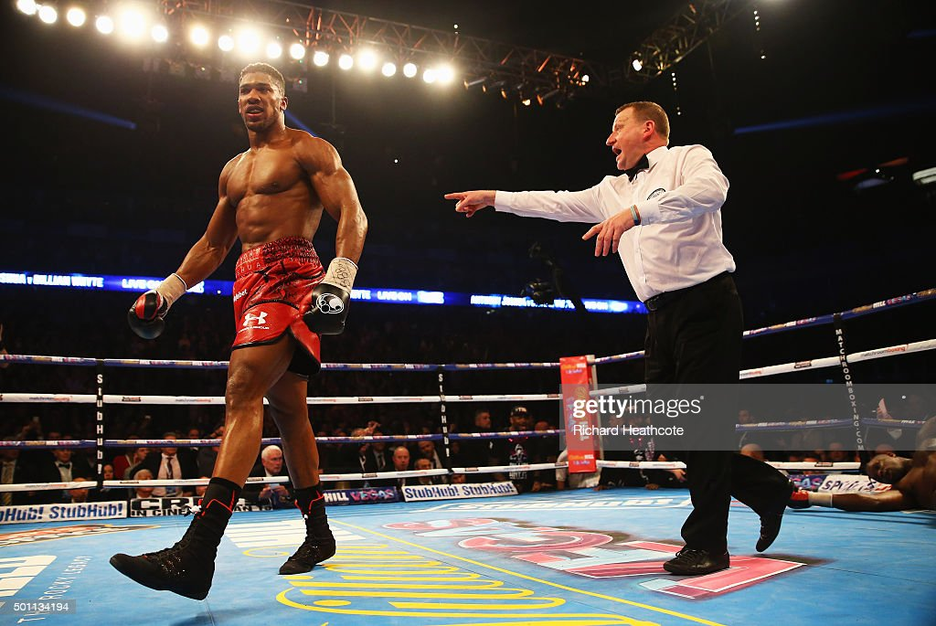 Anthony Joshua (L) is ordered to a neutral corner as he stops Dillian Whyte (R) in the seventh round during the British and Commonwealth heavyweight title contest at The O2 Arena on December 12, 2015 in London, England.