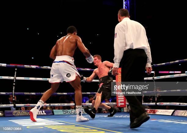 Anthony Joshua knocks down Alexander Povetkin during the IBF WBA Super WBO IBO World Heavyweight Championship title fight between Anthony Joshua and...