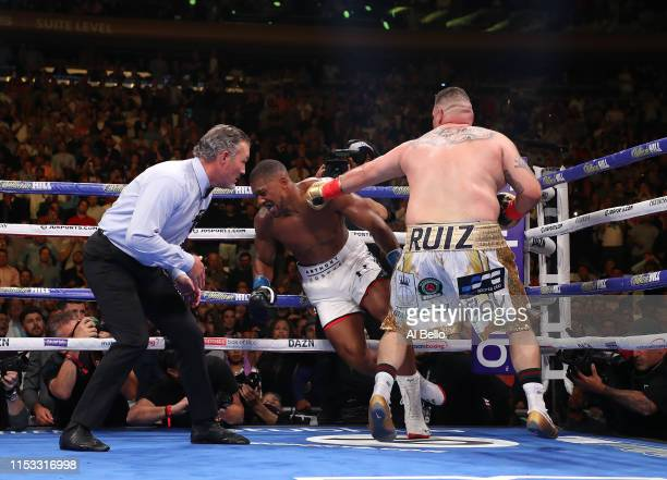 Anthony Joshua knocks down Andy Ruiz Jr in the third round during their IBF/WBA/WBO heavyweight title fight at Madison Square Garden on June 01 2019...