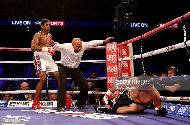Anthony Joshua knocks out Emanuele Leo during their Heavyweight bout at O2 Arena on October 5 2013 in London England