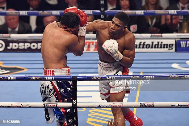 Anthony Joshua lands a right hand punch on Dominic Breazeale during their bout for the IBF World Heavyweight Title at The O2 Arena on June 25 2016 in...
