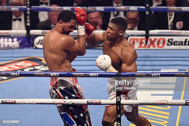 Anthony Joshua lands a right hand punch on Dominic Breazeale during the IBF World Heavyweight Title fight at The O2 Arena on June 25 2016 in London...
