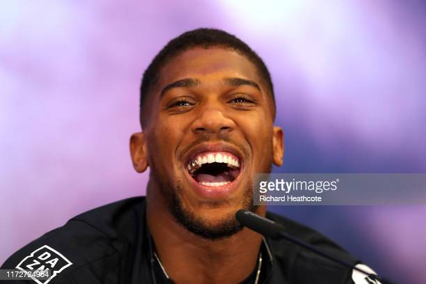 Anthony Joshua laughs during the press conference for Andy Ruiz Jr. V Anthony Joshua 2 'Clash on the Dunes' at the Hilton Syon Park on September 06,...