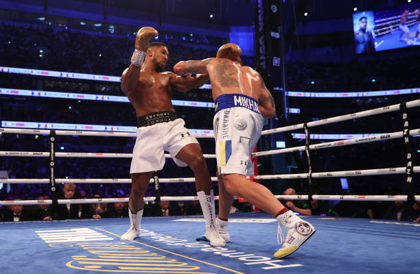 Anthony Joshua looks on as Oleksandr Usyk punches during the Heavyweight Title Fight between Anthony Joshua and Oleksandr Usyk at Tottenham Hotspur...