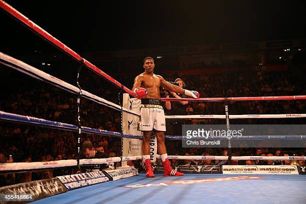 Anthony Joshua looks on from the corner of the ring during his heavyweight fight with Konstantin Airich at the Phones 4u Arena on September 13 2014...
