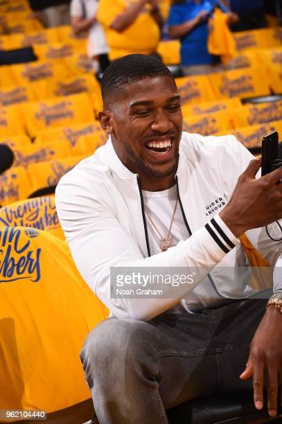 Anthony Joshua looks on in Game Four of the Western Conference Finals of the 2018 NBA Playoffs between the Houston Rockets and Golden State Warriors...