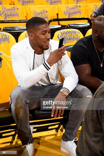 Anthony Joshua looks on prior to Game Four of the Western Conference Finals during the 2018 NBA Playoffs between the Houston Rockets and Golden State...