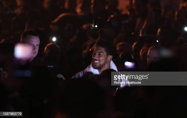 Anthony Joshua makes his way to the ring prior to the BF WBA Super WBO IBO World Heavyweight Championship title fight between Anthony Joshua and...