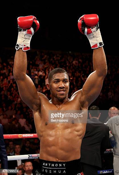 Anthony Joshua of England celebrates after defeating Kevin Johnson of The USA in their WBC International Heavyweight Championship bout at The O2...