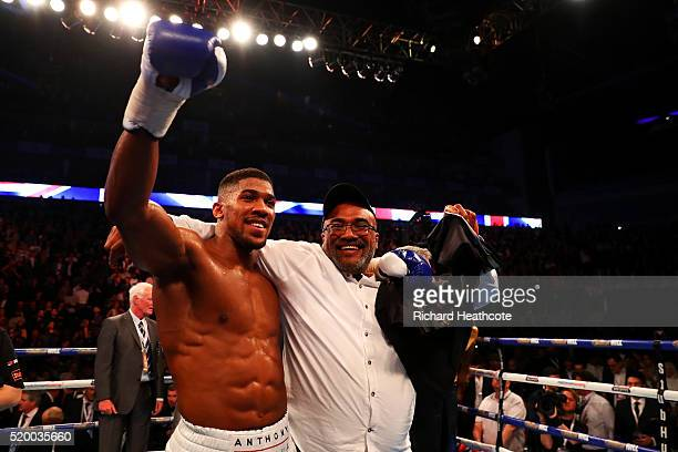 Anthony Joshua of England celebrates with his father Jonathan after defeating Charles Martin of the United States in action during the IBF World...
