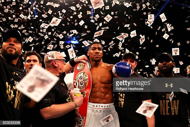 Anthony Joshua of England celebrates with the belt after defeating Charles Martin of the United States in action during the IBF World Heavyweight...