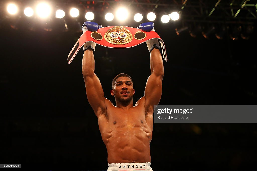 Anthony Joshua of England celebrates with the belt after defeating Charles Martin of the United States in action during the IBF World Heavyweight title fight at The O2 Arena on April 9, 2016 in London, England.