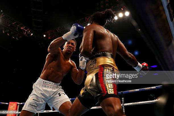 Anthony Joshua of England lands a punch on Charles Martin of the United States during the IBF World Heavyweight title fight at The O2 Arena on April...