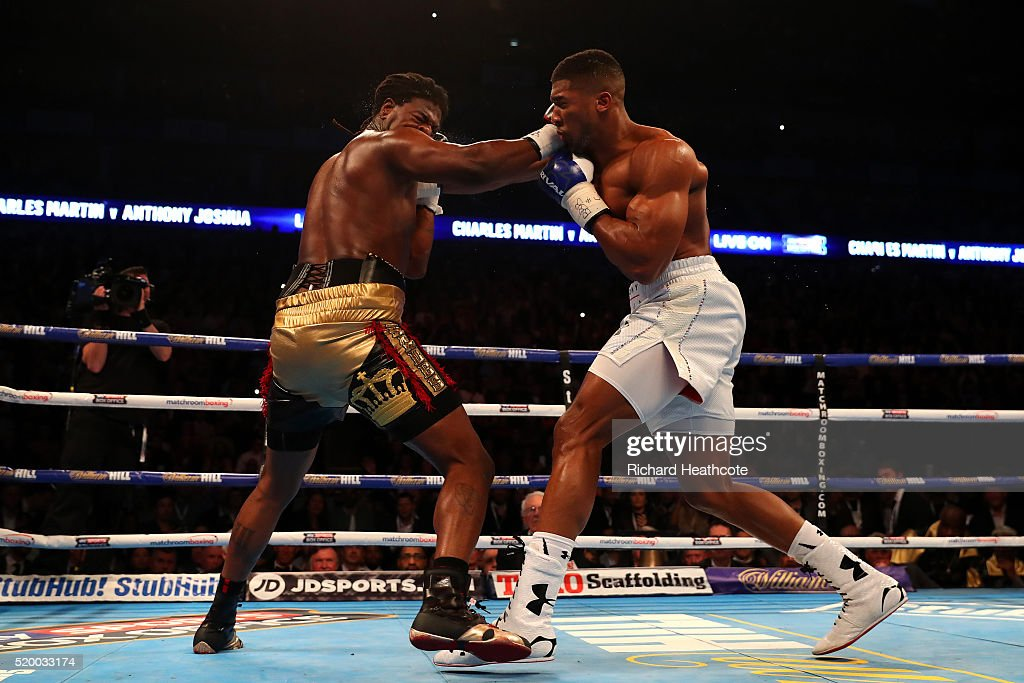 Anthony Joshua of England lands a punch that knocks Charles Martin of the United States to the canvas during the IBF World Heavyweight title fight at The O2 Arena on April 9, 2016 in London, England.