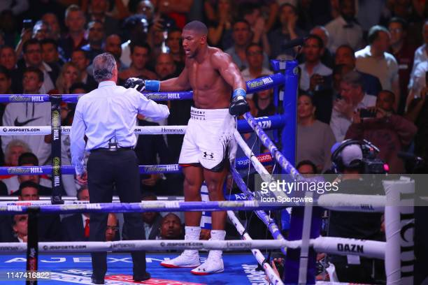 Anthony Joshua of England takes a standing 8 count and shortly after the fight is stopped during the World Heavyweight Championship fight on June 1...