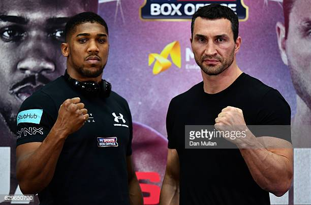 Anthony Joshua of Great Britain and Wladimir Klitschko of Ukraine pose together during a press conference at Wembley Stadium on December 14 2016 in...