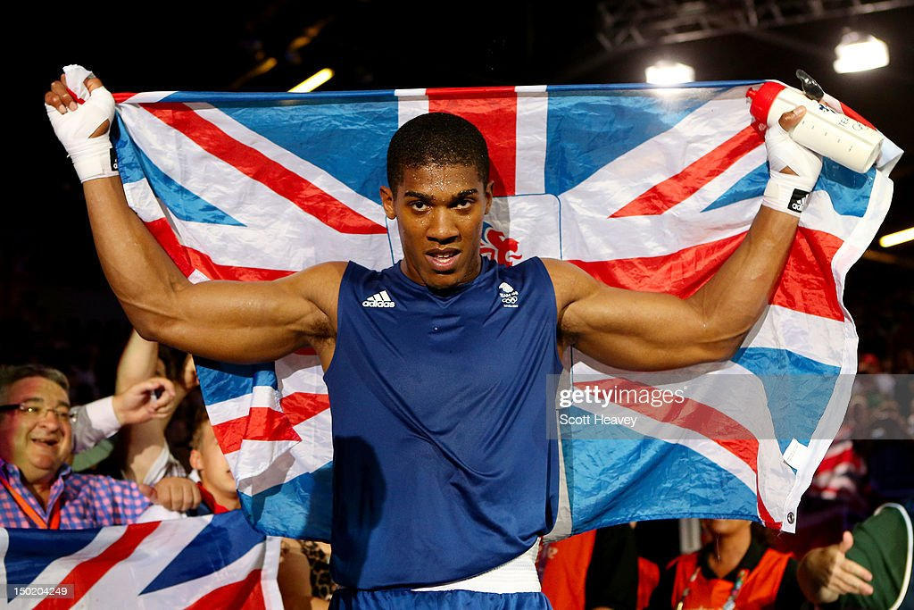 Anthony Joshua of Great Britain celebrates defeating Roberto Cammarelle of Italy to win the Men's Super Heavy (+91kg) Boxing final bout on Day 16 of the London 2012 Olympic Games at ExCeL on August 12, 2012 in London, England.