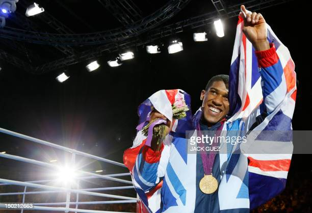 Anthony Joshua of Great Britain celebrates during the awards ceremony for the SuperHeavyweight boxing category of the 2012 London Olympic Games at...