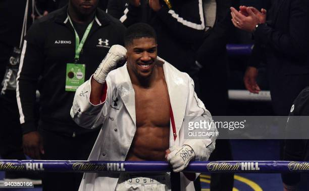 Anthony Joshua of Great Britain celebrates victory over Joseph Parker of New Zealand following their heavyweight unification bout at Principality...