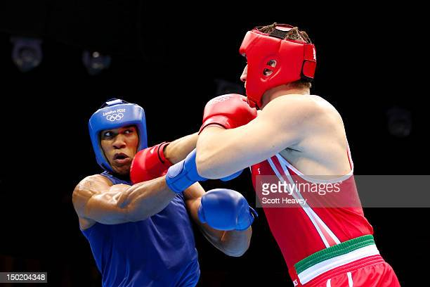 Anthony Joshua of Great Britain exchanges punches with Roberto Cammarelle of Italy during the Men's Super Heavy Boxing final bout on Day 16 of the...