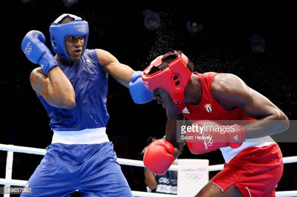 Anthony Joshua of Great Britain in action with Erislandy Savon Cotilla of Cuba during the Men's Super Heavy Boxing on Day 5 of the London 2012...