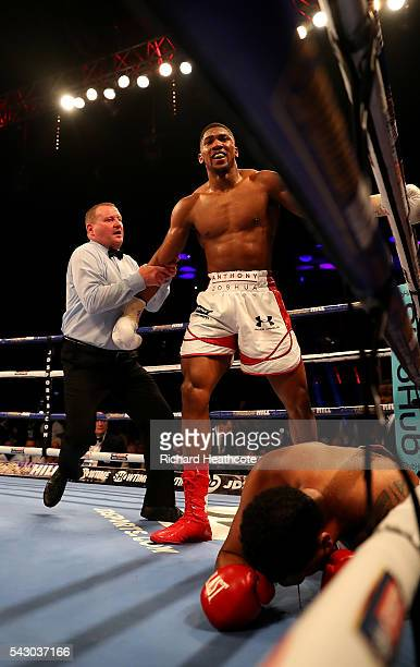 Anthony Joshua of Great Britain looks on after knocking down Dominic Breazeale of The USA during their IBF World Heavyweight Championship bout at The...