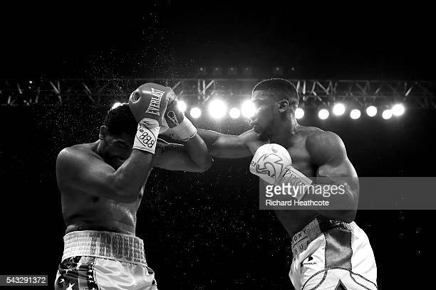 Anthony Joshua of Great Britain punches Dominic Breazeale of The USA during their IBF World Heavyweight Championship bout at The O2 Arena on June 25...