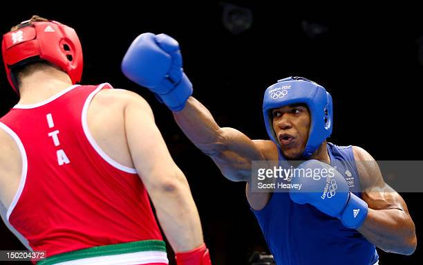 Anthony Joshua of Great Britain throws a punches against Roberto Cammarelle of Italy during the Men's Super Heavy Boxing final bout on Day 16 of the...