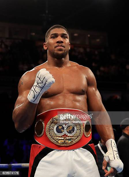 Anthony Joshua of London celebrates his victory over Eric Molina of the United States during their IBF World Heavyweight Championship fight at...