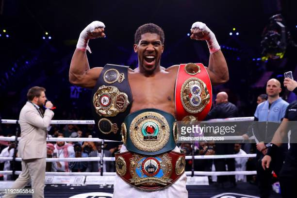 Anthony Joshua poses for a photo with the IBF WBA WBO IBO World Heavyweight Title belts after the IBF WBA WBO IBO World Heavyweight Title Fight...