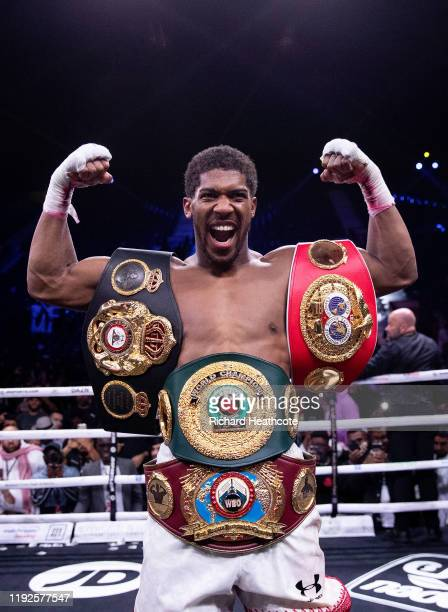 Anthony Joshua poses for a photo with the IBF, WBA, WBO & IBO World Heavyweight Title belts after the IBF, WBA, WBO & IBO World Heavyweight Title...