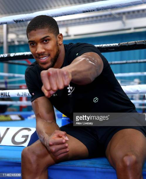 Anthony Joshua poses for photographers after a training session during the Anthony Joshua Media Day at the English Institute of Sport on May 01 2019...