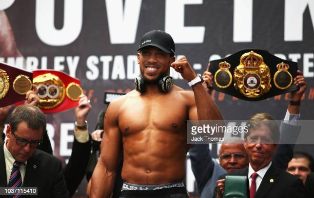 Anthony Joshua poses for the crowds on the scales during the Anthony Joshua And Alexander Povetkin weigh in on September 21 2018 in London England