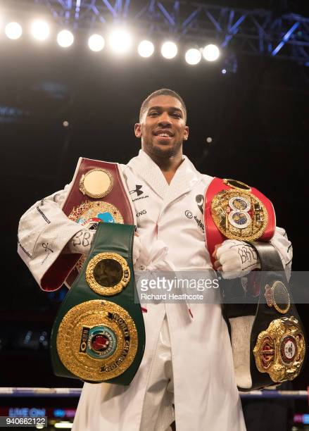 Anthony Joshua poses with his belts after his WBA IBF WBO IBO Heavyweight Championship title fight at Joseph Parker Principality Stadium on March 31...