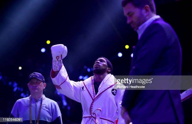 Anthony Joshua prepares in the ring as his trainer Robert McCracken and Eddie Hearn look on prior to the IBF WBA WBO IBO World Heavyweight Title...