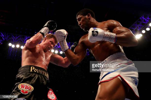 Anthony Joshua punches Alexander Povetkin during the IBF WBA Super WBO IBO World Heavyweight Championship title fight between Anthony Joshua and...