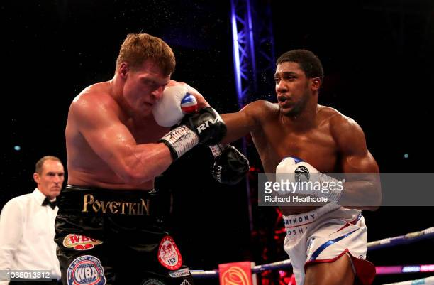 Anthony Joshua punches Alexander Povetkin during the IBF WBA Super WBO IBO World Heavyweight Championship title fight between Anthony Joshua and...