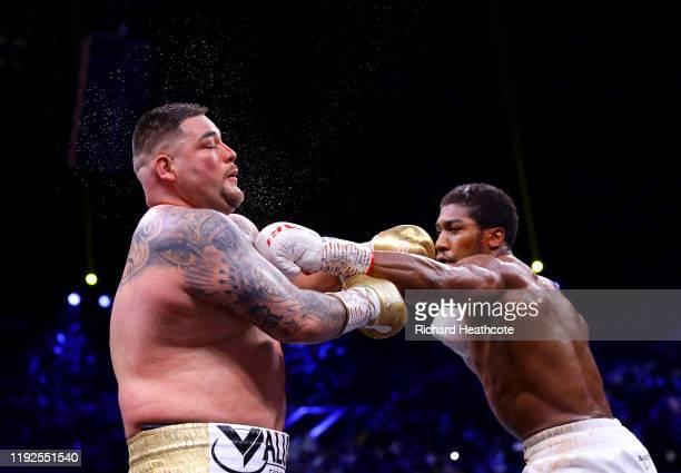 Anthony Joshua punches Andy Ruiz Jr during the IBF WBA WBO IBO World Heavyweight Title Fight between Andy Ruiz Jr and Anthony Joshua during the...