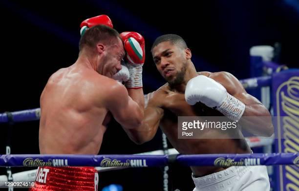 Anthony Joshua punches Kubrat Pulev during the IBF, WBA, WBO and IBO World Heayweight Title fight between Anthony Joshua and Kubrat Pulev at The SSE...
