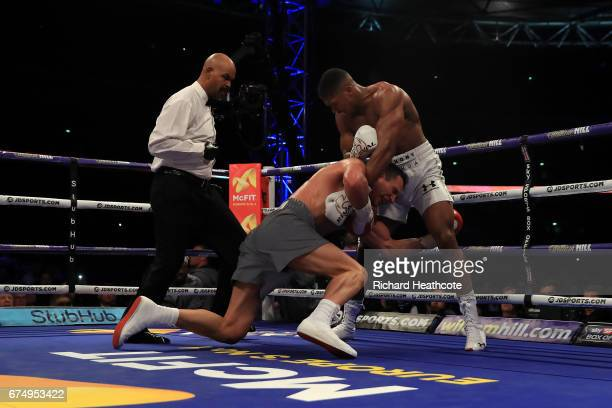 Anthony Joshua puts Wladimir Klitschko down in the 5th round during the IBF WBA and IBO Heavyweight World Title bout at Wembley Stadium on April 29...