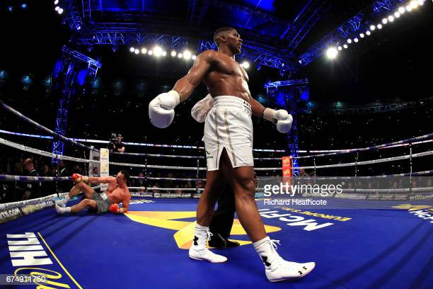 Anthony Joshua reacts after knocking down Wladimir Klitschko during the IBF WBA and IBO Heavyweight World Title bout at Wembley Stadium on April 29...
