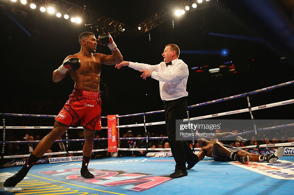 Anthony Joshua (L) reacts as he knocks Dillian Whyte (R) down in the seventh round during the British and Commonwealth heavyweight title contest at The O2 Arena on December 12, 2015 in London, England.