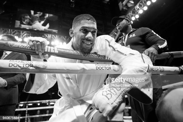 Anthony Joshua relaxes in the ring after his WBA IBF WBO IBO Heavyweight Championship title fight against Joseph Parker at Principality Stadium on...