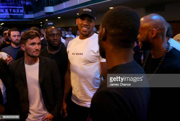 Anthony Joshua speaks to fans during the Commonwealth and WBA Continental Cruiserweight Championship's contest between Luke Watkins and Lawrence...