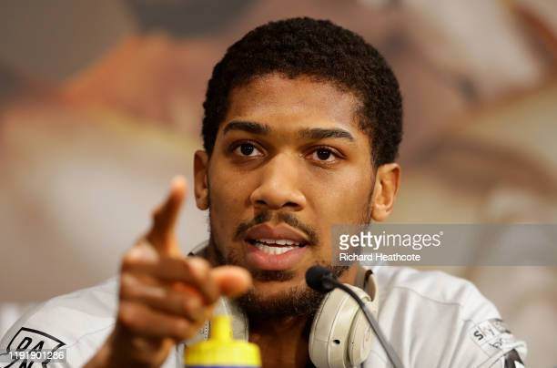 Anthony Joshua speaks to the media during the Clash On The Dunes Press Conference at the Diriyah Season Hospitality Lounge on December 04 2019 in...