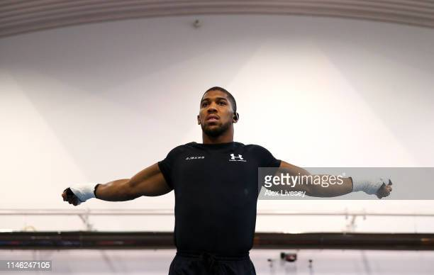 Anthony Joshua stretches during a training session during the Anthony Joshua Media Day at the English Institute of Sport on May 01 2019 in Sheffield...