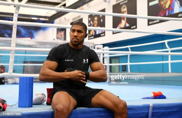 Anthony Joshua tapes his hands up prior to a training session during the Anthony Joshua Media Day at the English Institute of Sport on May 01 2019 in...