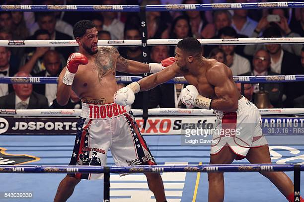 Anthony Joshua throws a right hand punch against Dominic Breazeale during their bout for the IBF World Heavyweight Title at The O2 Arena on June 25...